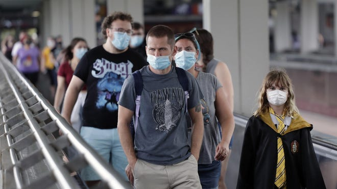 Guests arrive at Universal Orlando Resort in Orlando on June 3. Amusement parks of all sizes are adjusting everything from selling tickets to serving meals while trying to reassure the public and government leaders that they're safe to visit amid the coronavirus pandemic and warnings against large gatherings. Numbers reported by the state Department of Health Saturday mark the 10th out of 11 straight days in which new cases have topped 1,000.