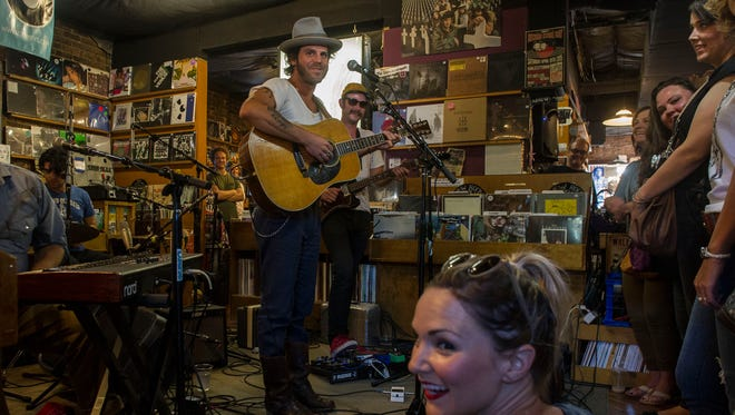 Langhorne Slim and The Law perform at Grimey's New and Preloved Music on Friday Aug. 21, 2015, in Nashville in Tenn.
