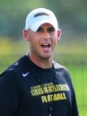 St. Norbert College football coach Steve Opgenorth during practice at Schneider Stadium on Friday.