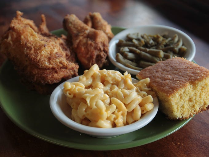 Food 4 Ur Soul offers downhome meals such as deep fried chicken, mac and cheese with green beans and corn bread at the restaurant at 612 South Fifth Street in downtown Louisville.