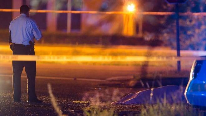 Montgomery Police investigate a shooting death on Ivy Lane and South Blvd. Service Road in Montgomery, Ala., on Wednesday June 3, 2015.