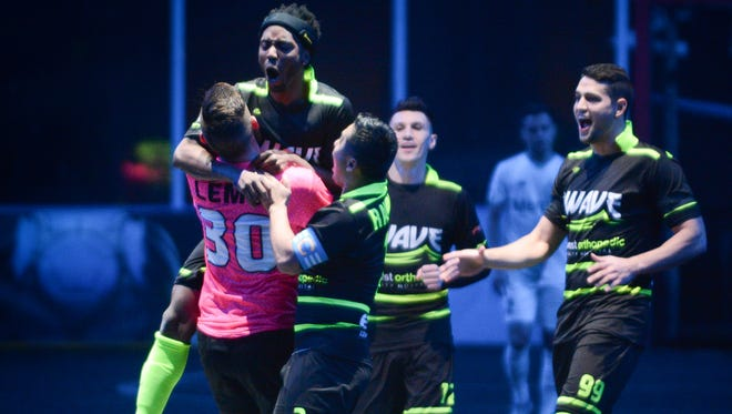 Max Ferdinand of the Milwaukee Wave leaps into the arms of goalkeeper Josh Lemos to celebrate one of his two goals on the night against the St. Louis Ambush.