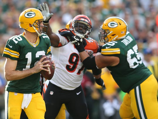 Green Bay Packers quarterback Aaron Rodgers (12) rolls