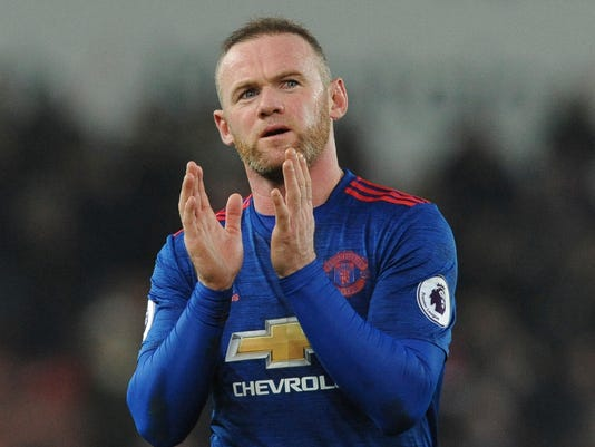 FILE - In this Jan. 21, 2017 file photo, Manchester United's Wayne Rooney waves to fans after the English Premier League soccer match between Stoke City and Manchester United at the Britannia Stadium, Stoke on Trent, England. There was wide speculation that Rooney was being enticed with big-money offers from China but ended up staying at Old Trafford. (AP Photo/Rui Vieira, File)