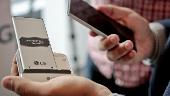 The LG G5 phone is shown with the bottom of the phone popped out. The module contains the battery, which can be removed and inserted into a different module with extra features, such as a camera grip with physical shutter buttons. LG is dipping its toes into a modular-design concept with its upcoming G5 smartphone.