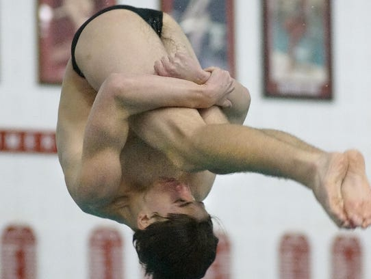 Plymouth's Jordan Groves completes a front double pike