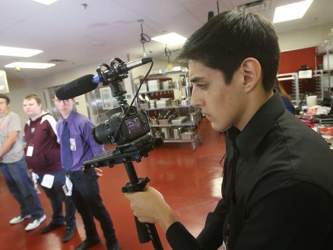 Rancho Mirage High School student Cesar Castro prepares