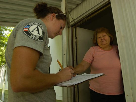 Residents of Mobile Gardens near Blades cleaned up after flooding in 2006.  AmeriCorps member Karen Thornton gets contact information as well as a damage assessment from home owner Judy Williams (cq) on Woodbine Street in Mobile Gardens.