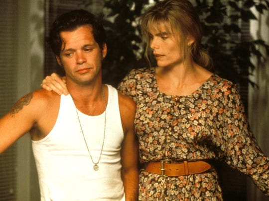 "John Mellencamp, left, portrayed Bud Parks in ""Falling From Grace."" Mariel Hemingway portrayed his wife, Alice."