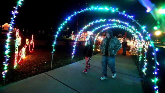 Kinsley and Ralph Watkins enjoy a chilly night at Patriots Park in 2019. Kings Mountain plans to display their Christmas lights around downtown and Patriots Park this year.