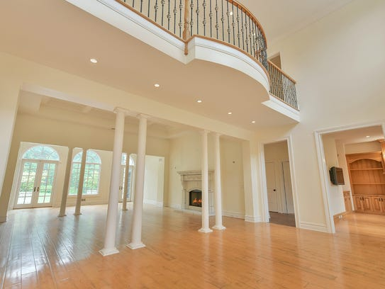 Home Group Foyer : Bernardsville manor home makes a statement on