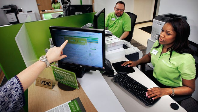 In this file photo, Bankers Erin Henderson (right) and Jason Nickel get some practice time on Regions Bank's two-screen system which allows better interaction with customers visiting the bank's  branch on Main St.  (Jim Weber/The Commercial Appeal)