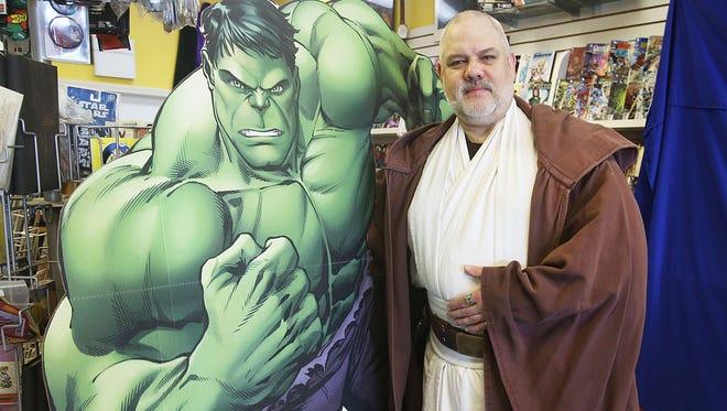 "Tony Grove, owner of Tony's Kingdom of Comics, dresses as Obi-Wan Kenobi from ""Star Wars,"" standing next to his good friend, the Incredible Hulk."