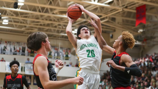 Action during the Floyd Central-New Albany High School boys basketball game Dec. 8 in Floyds Knobs.