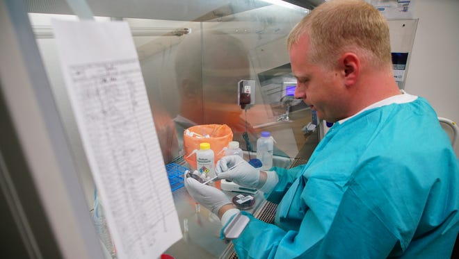 Ben Voshell, a microbiologist for the Delaware Health and Social Services Public Health Lab, stores super resistant bacteria being studied in the molecular lab.