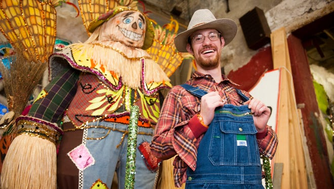 Doug Hoffman, a 23-year-old resident of the Bancroft Neurohealthfacility in Woodstown, stands in front of the costume he will wear in today's Mummers Parade in Philadelphia. He is among scores of young people keeping the Mummer tradition alive.