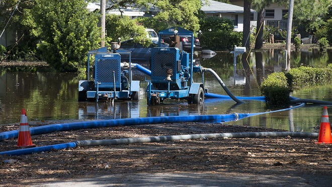Pumps attempt to drain flooded areas in Gulf Breeze recently.