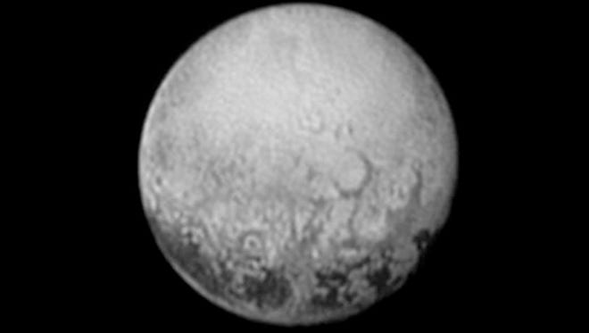 This July 11, 2015, image provided by NASA shows Pluto from the New Horizons spacecraft. On Tuesday, July 14, NASA's New Horizons spacecraft will come closest to Pluto. New Horizons has traveled 3 billion miles over 9½ years to get to the historic point.