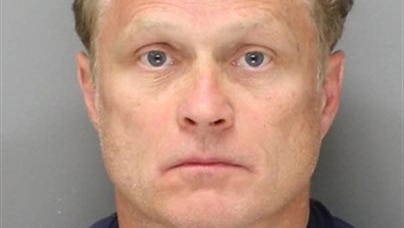 In this undated photo provided by the Philadelphia Police Department, Gary Dudek, 54, of Wallingford, Pa., is shown. Dudek, a former medical company sales representative was arrested in Monday, May 26, 2014 and charged charged with stealing more than $350,000 worth of human skin over a period of several years.  (AP Photo/Philadelphia Police Department)