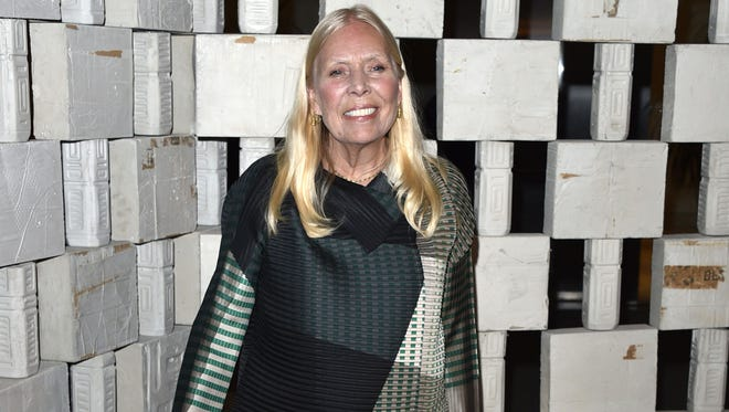 "Oct. 11, 2014 file photo, Joni Mitchell arrives to the Hammer Museum's ""Gala In The Garden,"" in Los Angeles. Mitchell's friend and conservator says it was an aneurysm that sent the folk singer to the hospital in March 2015. Conservator Leslie Morris acknowledged the aneurysm in a statement posted on Mitchell's website on Sunday, June 28, 2015, providing the first significant details on Mitchell's health status in the months since an ambulance was sent to her Los Angeles house to take her to the hospital."