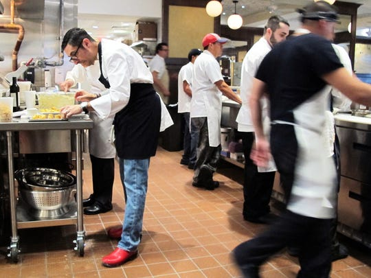 Chef-owner Vincenzo Betulia, left, prepares appetizers with his team at The French in Naples.