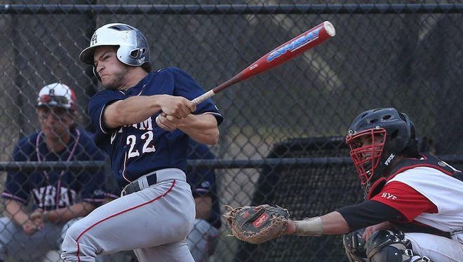 Byram Hills' Frank Vesuvio (22) swinging against Rye during a baseball game at Disbrow Park in Rye May 12, 2015. Byram Hills won the game 15-2.