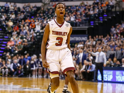 Tindley Tigers' Hunter White (3) celebrates after putting