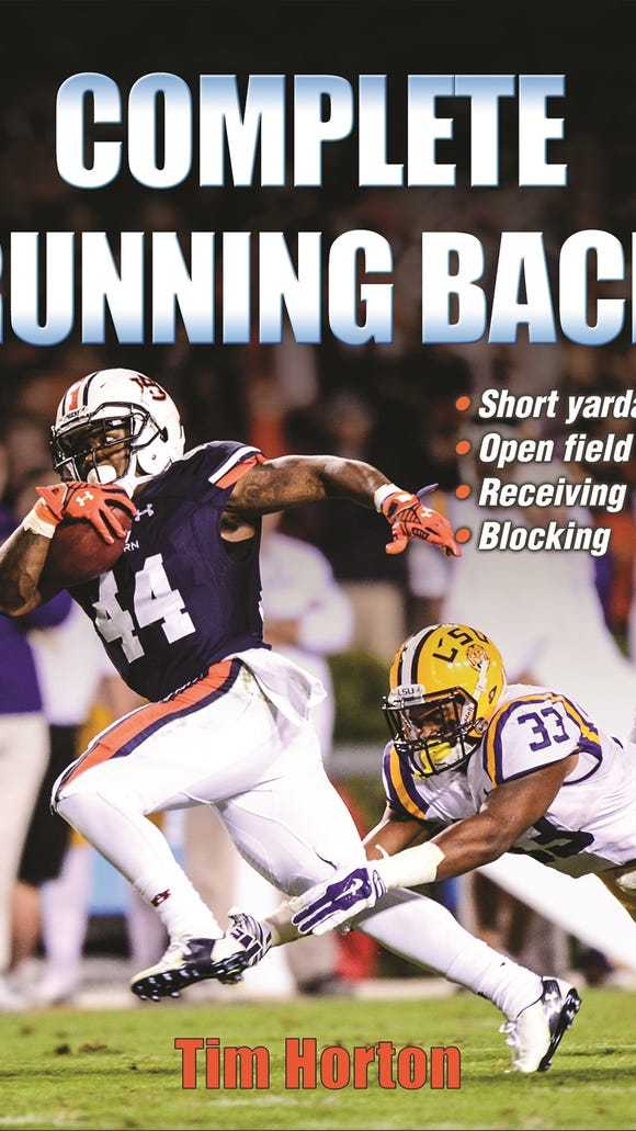 """Auburn assistant Tim Horton's 2016 book, """"Complete Running Back"""" talks about four key aspects of playing the position."""