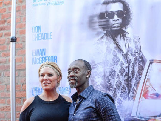 Don Cheadle stops to pose for a picture with Kristen Schlotman, executive director of the Cincinnati Film Commission.