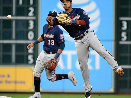 Minnesota Twins shortstop Jorge Polanco, right, throws out Houston Astros' Jose Altuve during the seventh inning of a baseball game, Wednesday, April 24, 2019, in Houston. (AP Photo/Eric Christian Smith)