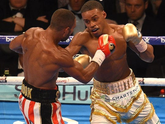 Errol Spence Jr., right, prepares to throw a left against Kell Brook on May 27.