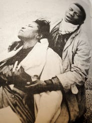 Amelia Boynton Robinson is comforted after being beaten