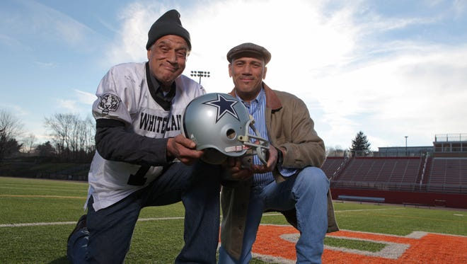 Dennis, left, and his brother Charles Morgan, both former White Plains High School football players, are photographed on the school football field Dec. 30, 2011. Dennis, who went on to play in the NFL for two seasons, passed away on Oct. 25.