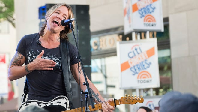 """Keith Urban performs on NBC's """"Today"""" show at Rockefeller Plaza on Thursday."""