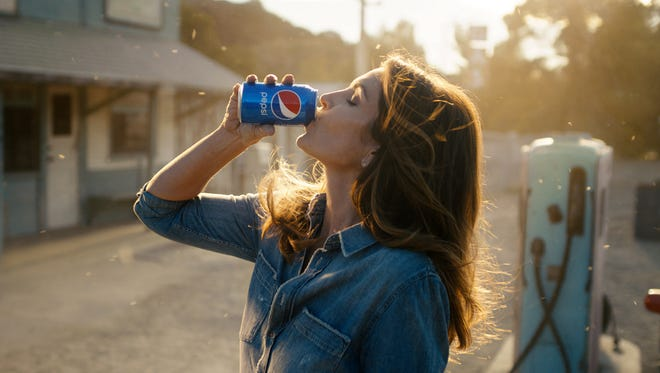 Some 26 years after her iconic Pepsi ad, Cindy Crawford is recreating the fizz with a new Super Bowl ad featuring her son, son, Presley Walker Gerber.