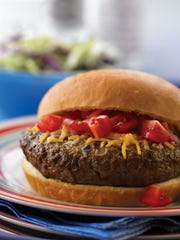 Ground cumin and Mexican cheese blend lend Southwest style to burgers.