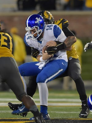 UK quarterback Patrick Towles (14) is sacked by Missouri Tigers defensive lineman Shane Ray (56) during the second half of last Saturday's game.