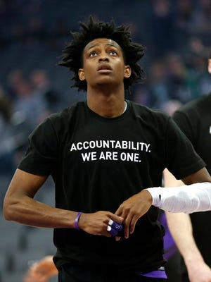 Sacramento Kings guard De'Aaron Fox stands on the court before the start of the game against the Boston Celtics.