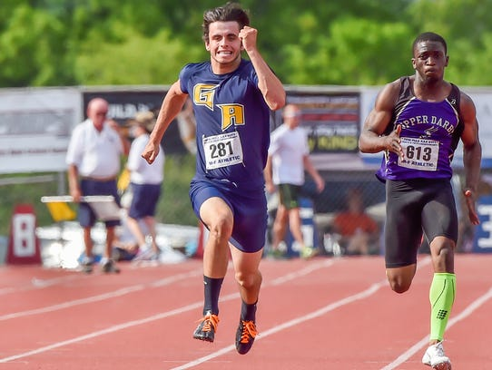 Greencastle's Liam Okal runs in the Class AAA boys