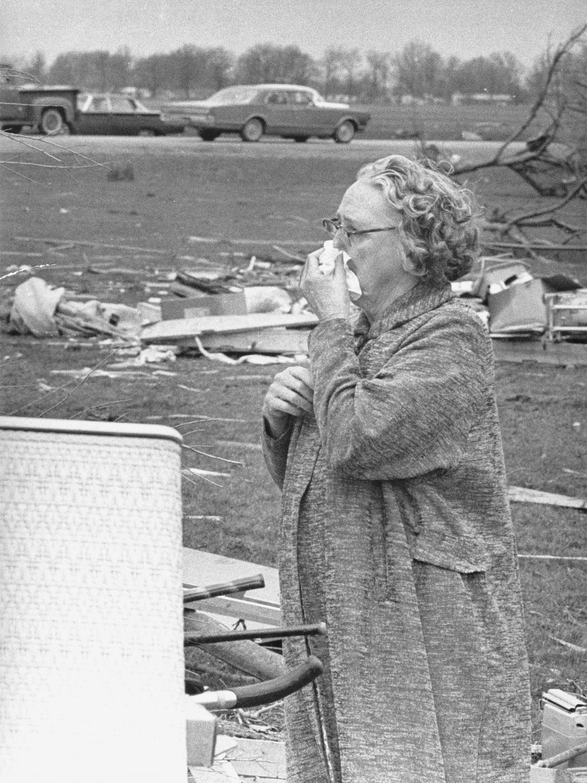 Mrs. Clifford Davis reacts to seeing the ruins of the