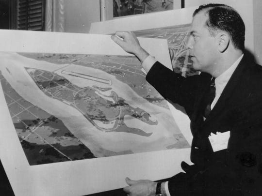 Detroit Mayor Jerome Cavanaugh inspects drawing of proposed Olympics rowing site at Belle Isle after U.S. Olympics Committee reconfirmed its choice of Detroit as the U.S. city which should bid for the 1968 Olympic Games on March 18, 1963.