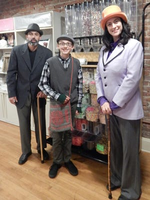 """Fowlerville Community Theatre will perform """"Willy Wonka."""" From left are Jason Brake as """"Grandpa Joe,"""" Aiden Brake as """"Charlie Bucket"""" and Elizabeth Derkin as """"Willy Wonka."""""""