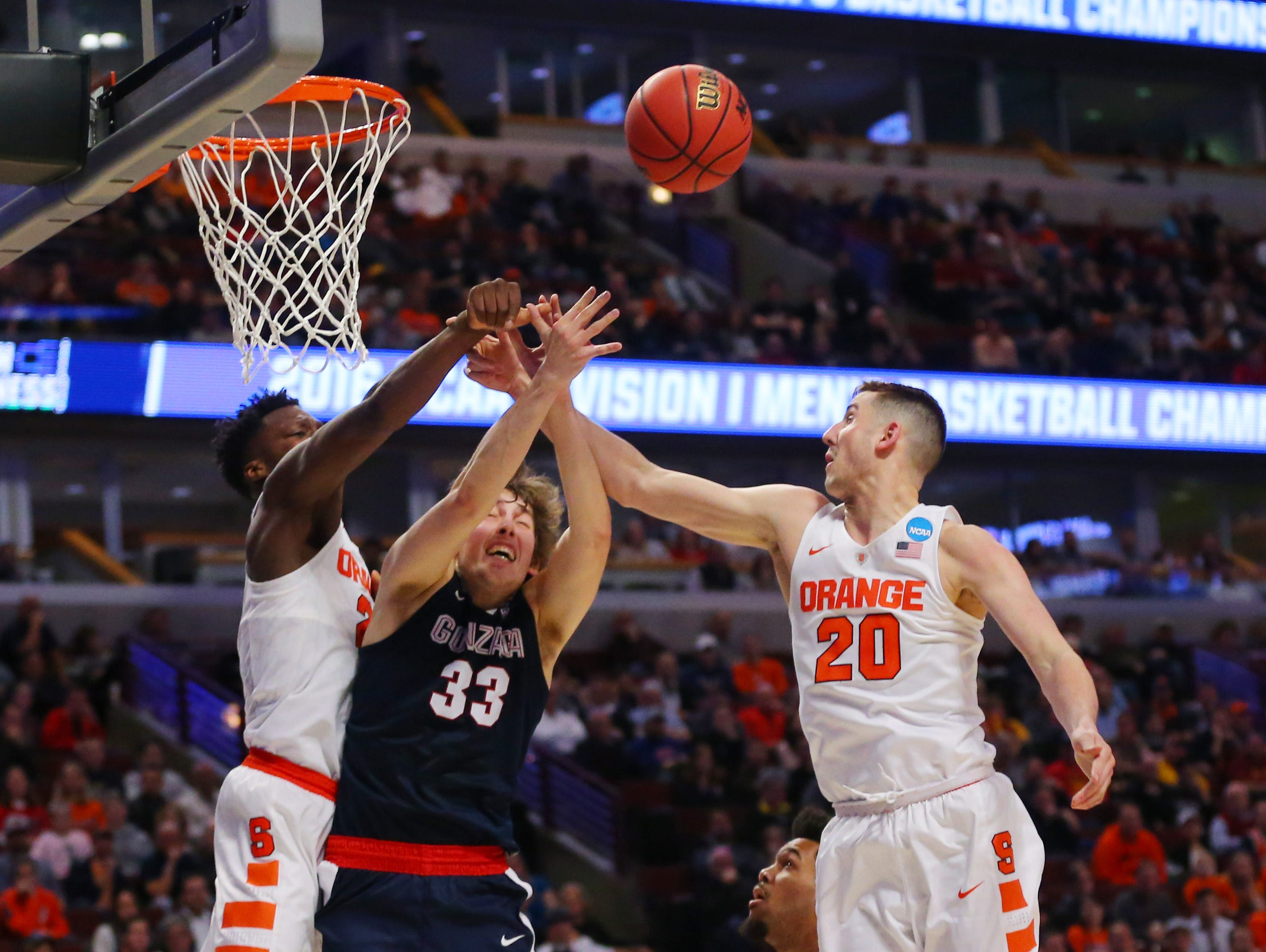 Mar 25, 2016; Chicago, IL, USA; Gonzaga Bulldogs forward Kyle Wiltjer (33) battles for the ball between Syracuse Orange forward Tyler Lydon (20) and forward Tyler Roberson (21) during the second half in a semifinal game in the Midwest regional of the NCAA Tournament at United Center. Mandatory Credit: Dennis Wierzbicki-USA TODAY Sports