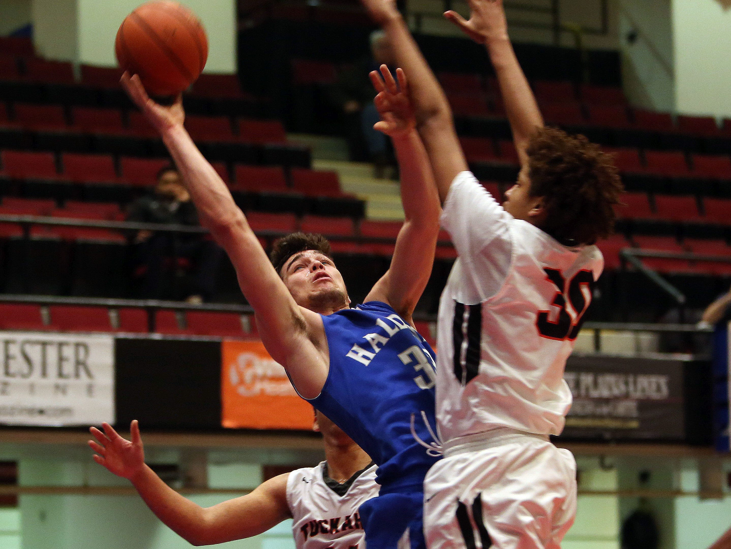 Haldane's Will Zuvic (33) goes up for a shot in front of Tuckahoe's Bryan Murray (30) during first half action in the boys Class C semifinal at the Westchester County Center in White Plains Feb. 24, 2016. Haldane won the game 44-34.