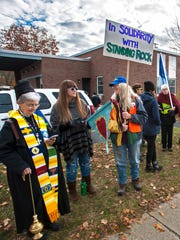 More than 100 demonstrators gather outside the Prouty Federal Building in Essex Junction on Tuesday, November 15, 2016, to protest against the Dakota Access Pipeline.