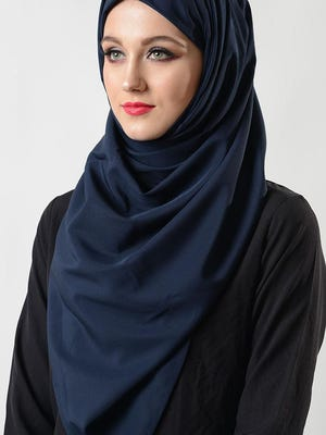 A woman wearing the hijab, a scarf-like head and neck covering traditionally worn by religious Muslim women.