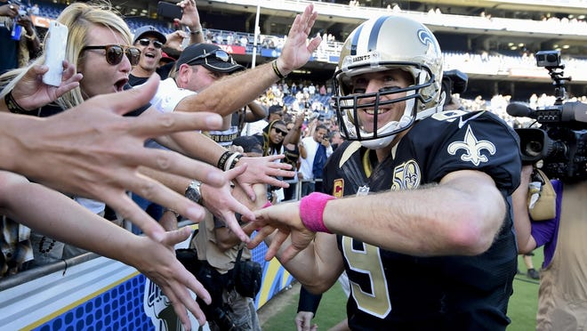New Orleans Saints quarterback Drew Brees reacts with fans after New Orleans defeated San Diego, 35-34, on Sunday.