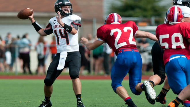 Marine City senior Alex Merchant looks to pass during Saturday's game at East China Stadium.