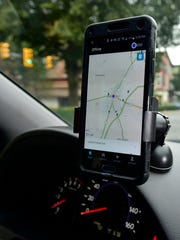 Uber drivers use the phone app to locate fares. Glen