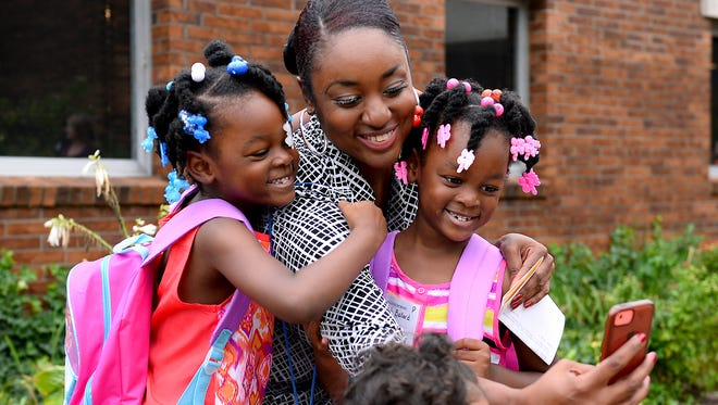 Chantail Naranjo takes a selfie with her twin daughters Myklah, left, and Alanah, 5, Tuesday, September 8, 2015, before the start of the first day of school at Wilcox Elementary in Holt.